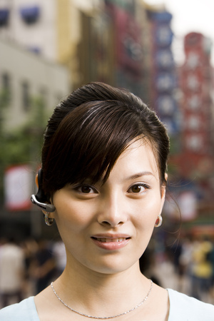 Woman With A Cell Phone Earpiece