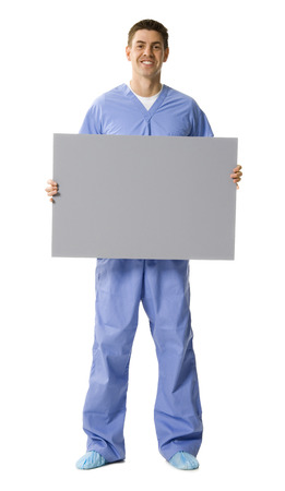 caregivers: Male Doctor Or Nurse Holding Blank Sign Smiling