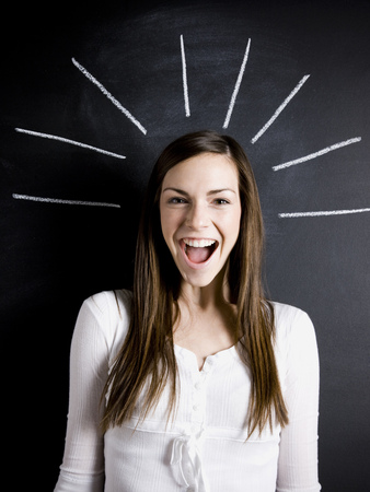 beaming: Young Woman Against A Chalkboard