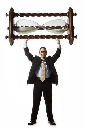 Businessperson Holding Up An Hourglass