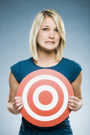 Woman Holding Up A Target LANG_EVOIMAGES