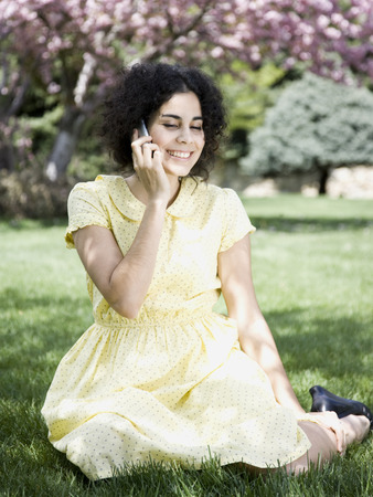 Woman In A Yellow Dress On The Phone LANG_EVOIMAGES