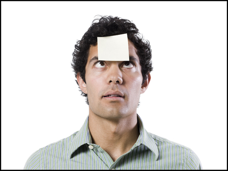 Man With A Post It Note On His Forehead