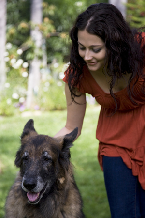 Woman Outdoors With Her Dog LANG_EVOIMAGES
