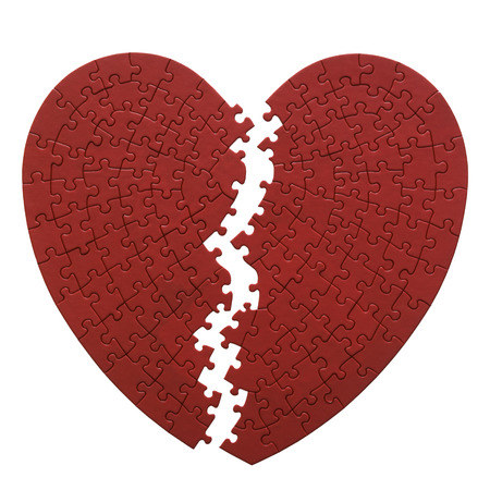 Red Heart Shaped Jigsaw Puzzle On A White Background