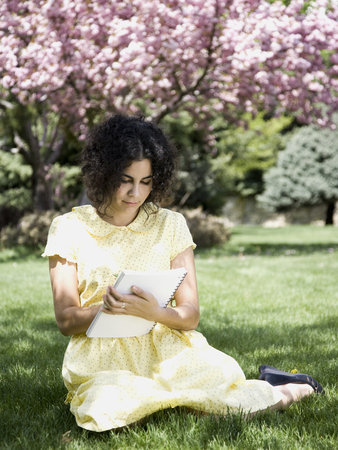 Woman In A Yellow Dress With Her Diary