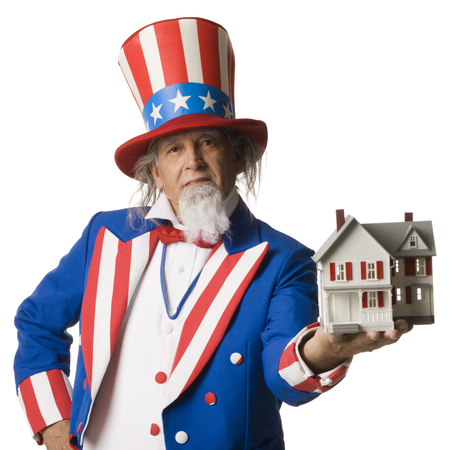 Uncle Sam Holding A House In His Hand