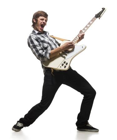 plucking: Young Man Playing Electric Guitar, Shouting LANG_EVOIMAGES