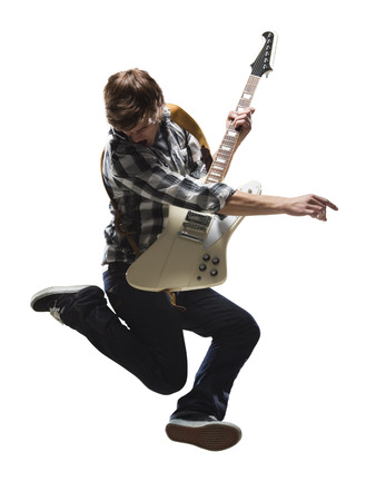 plucking: Young Man Playing Electric Guitar And Jumping LANG_EVOIMAGES