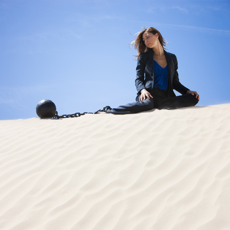 Usa, Utah, Little Sahara, Businesswoman Wearing Ball And Chain In Desert