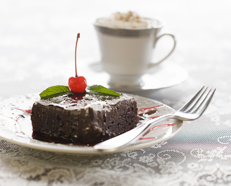 Close-Up Of A Fork On A Slice Of Cake
