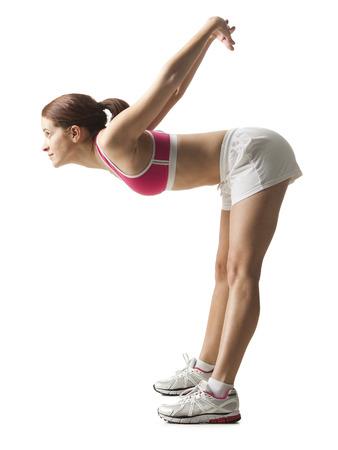 Young Woman Stretching, Studio Shot