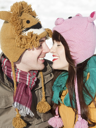 Orem, Utah, Usa, Boyfriend And Girlfriend Wearing Funny Knit Hats Touching With Noses LANG_EVOIMAGES