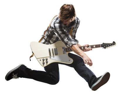 button: Young Man Playing Electric Guitar And Jumping LANG_EVOIMAGES