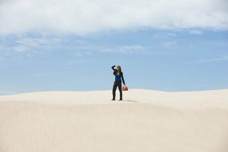 gas can: Usa, Utah, Little Sahara, Young Businesswoman Standing On Desert Carrying Gas Can LANG_EVOIMAGES