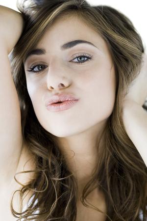 puckered lips: Woman Looking At Camera