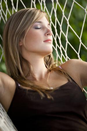 Teenage Girl In A Hammock Sleeping LANG_EVOIMAGES