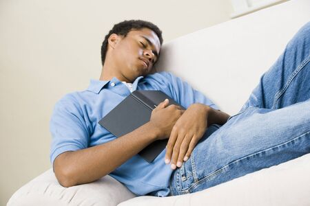 Teenage Boy Who Fell Asleep Reading LANG_EVOIMAGES