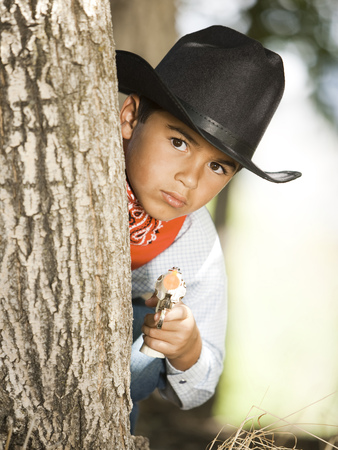 Boy In Cowboy Costume With Toy Gun LANG_EVOIMAGES