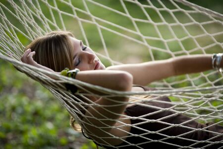 Teenage Girl In A Hammock Sleeping LANG_EVOIMAGES