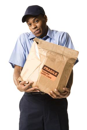 Deliveryman Holding A Damaged Parcel