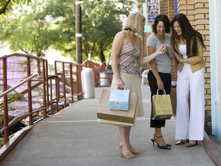 clutch bag: Three Girl Friends Looking At A Ring
