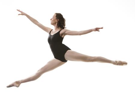 Woman Doing A Ballet Jump LANG_EVOIMAGES