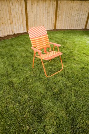 Superieur Orange Lawn Chair Outside Stock Photo   88377479