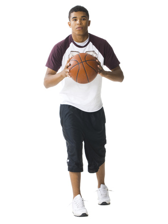 Teenage Boy Dribbling A Basketball