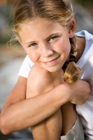 Little Girl Sitting Outside LANG_EVOIMAGES