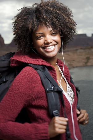 Woman With Backpack And Earbuds