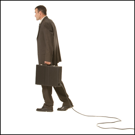 Businessman With Briefcase And Cable
