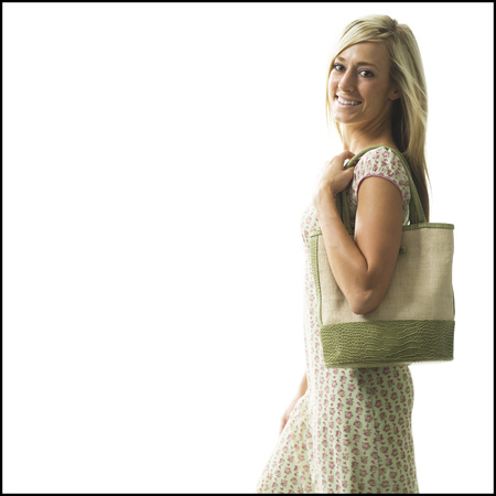 Woman Standing Holding A Bag