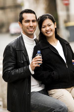 Girlfriend Giving Boyfriend A Drink Of Water
