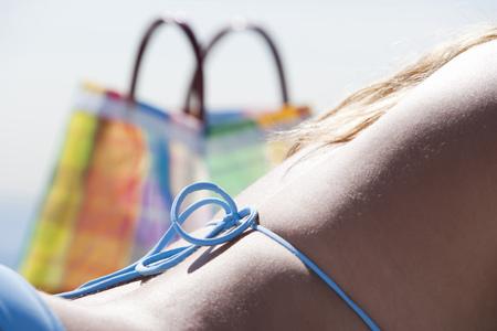 Back Of Woman Sunbathing LANG_EVOIMAGES
