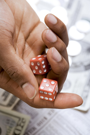 ManS Hand Rolling A Pair Of Dice