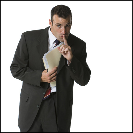 Businessman Putting Files Into His Jacket