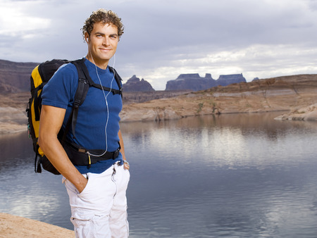 Man With Backpack And Scenic Background