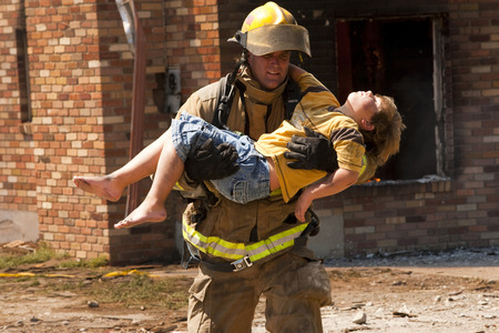Fire Fighter Rescuing Child LANG_EVOIMAGES