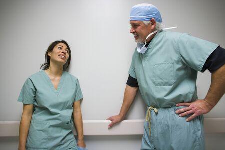 Doctor And Nurse In Scrubs Talking