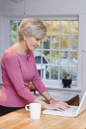 Mature Woman With Laptop
