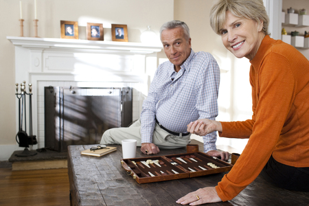 Mature Couple Playing Backgammon LANG_EVOIMAGES