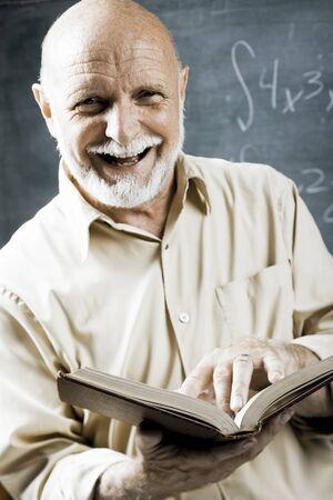 the elderly tutor: Male School Teacher With Book