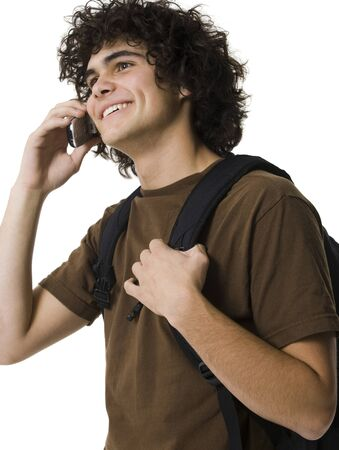 Teenage Boy Talking On Cell Phone Holding Backpack
