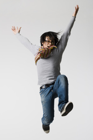 puños cerrados: Man With Eyeglasses Leaping With Arm Up And Closed Fists