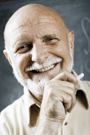 the elderly tutor: Male School Teacher Laughing