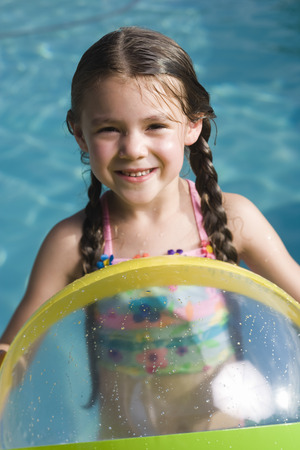 Young Girl In Floatation Tube In Water