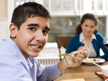 Boy Eating Green Beans