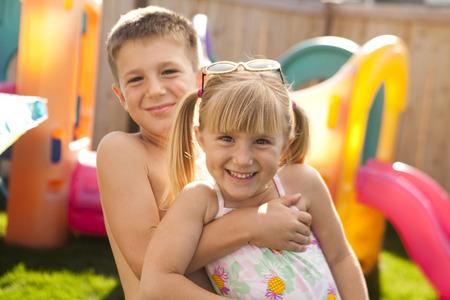 embraced: Boy Embracing Girl Smiling