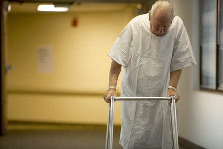 Mature Man In Hospital Gown With Walker LANG_EVOIMAGES